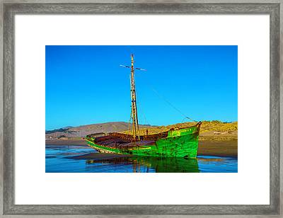 Low Tide Green Fishing Boat Framed Print by Garry Gay