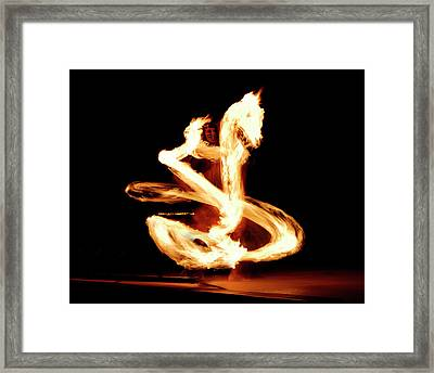 Luau Fire Dancer At Night With A Flaming Dragon Framed Print by Reimar Gaertner