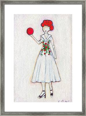 Lucy's Rosey Red Ball Framed Print by Ricky Sencion