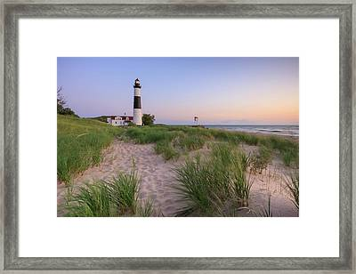 Framed Print featuring the photograph Ludington Beach And Big Sable Point Lighthouse by Adam Romanowicz