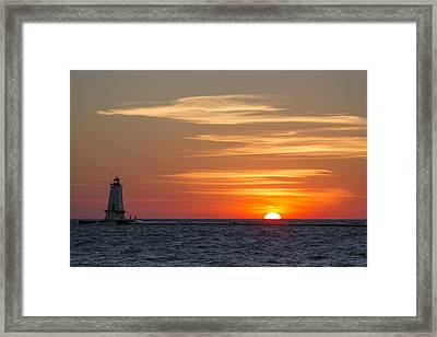 Ludington North Breakwater Light At Sunset Framed Print by Adam Romanowicz