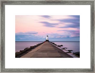 Framed Print featuring the photograph Ludington North Breakwater Light Sunrise by Adam Romanowicz