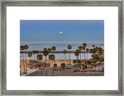 Lunar Eclipse Moonset Framed Print by Eddie Yerkish