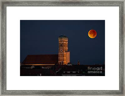 Lunare Eclipse Above Munich Framed Print by Hannes Cmarits