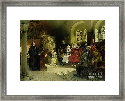 Luther Preaches Using His Bible Translation While Imprisoned At Wartburg Framed Print by Hugo Vogel