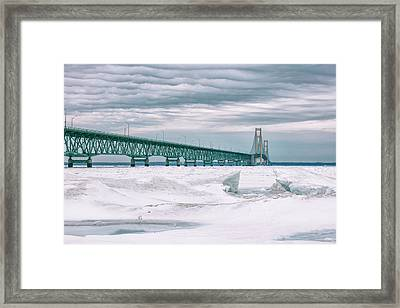 Framed Print featuring the photograph Mackinac Bridge In Winter During Day by John McGraw