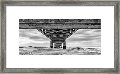 Framed Print featuring the photograph Mackinac Bridge In Winter Underneath  by John McGraw