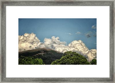 Mad Looking Clouds Framed Print