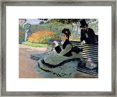 Madame Monet On A Garden Bench Framed Print by Claude Monet