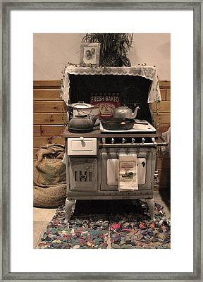 Maddie's Old Stove Framed Print by Nancy TeWinkel Lauren