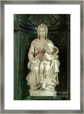 Madonna And Child By Michelangelo  Framed Print