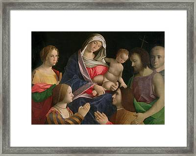 Madonna And Child With Saint John The Baptist Two Saints And Donors Framed Print