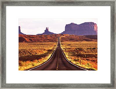 Magestic And Lonesome Road To Monument Valley Framed Print by Kim Lessel