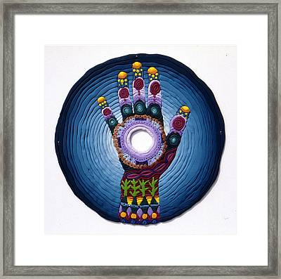 Magic Hand Framed Print by Arla Patch