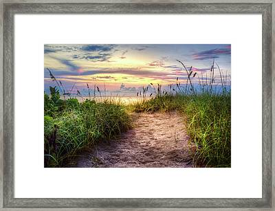 Framed Print featuring the photograph Magical Light In The Dunes by Debra and Dave Vanderlaan