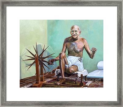 Mahatma Gandhi Spinning Framed Print by Dominique Amendola
