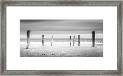 Main Beach Pilings Bw Framed Print by Ryan Moore