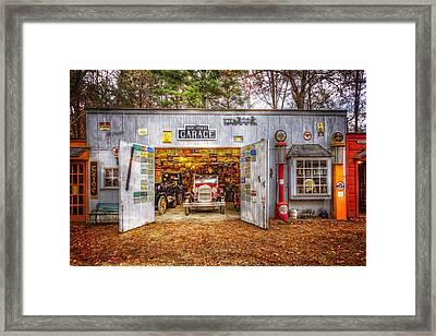 Main Street Garage Framed Print by Debra and Dave Vanderlaan