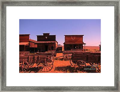 Main Street In An Old Western Town Framed Print by John Malone