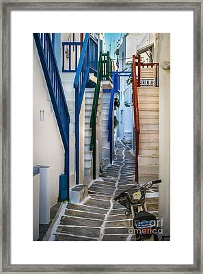 Main Street Mykonos Framed Print by Ken Andersen