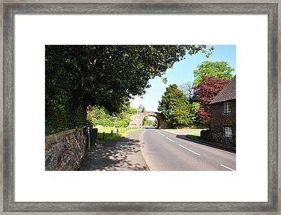 Main Street Ticknall And The Tramway Bridge Framed Print by Rod Johnson