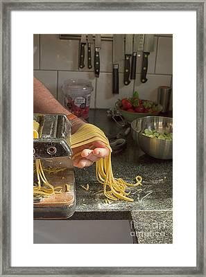 Framed Print featuring the photograph Making Pasta by Patricia Hofmeester