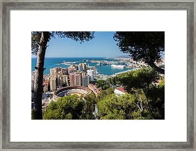 Malaga, Spain.  Overall View Bullring And Port. Framed Print by Ken Welsh
