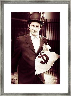 Male Banker Holding Dollar Sign Money Bags Framed Print by Jorgo Photography - Wall Art Gallery