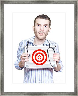 Male Doctor With Donation Target To Aim For Cure Framed Print by Jorgo Photography - Wall Art Gallery