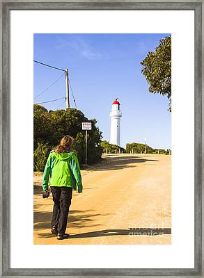 Male Explorer Sightseeing Lighthouse  Framed Print by Jorgo Photography - Wall Art Gallery