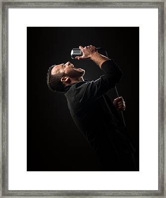 Male Singer Singing In Mic Framed Print