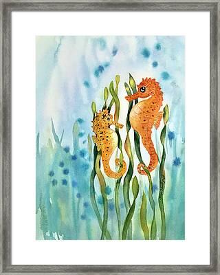 Mamma And Baby Seahorses Framed Print