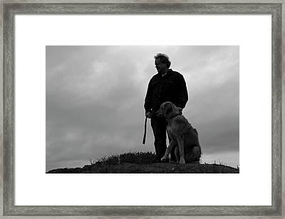 Man And His Dog In Silhouette Framed Print by Lorraine Devon Wilke