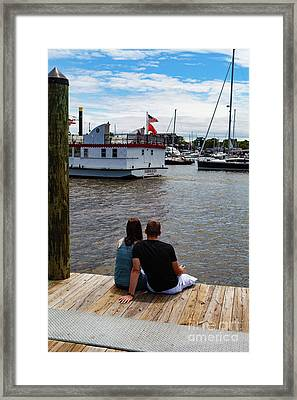 Man And Woman Sitting On Dock Framed Print