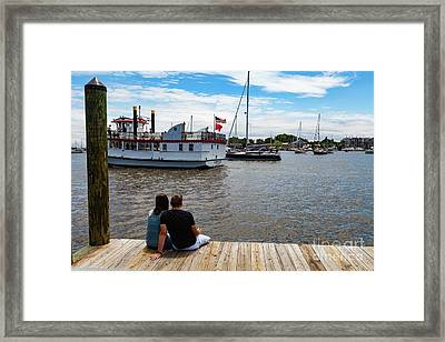Man And Woman Sitting On The Dock Framed Print