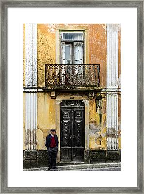 Man At The Door Framed Print by Marco Oliveira