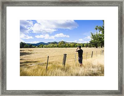 Man Enjoying A Rural Farm Landscape In Hobart Framed Print by Jorgo Photography - Wall Art Gallery