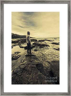 Man Gazing Out On Coastal Rocks Framed Print by Jorgo Photography - Wall Art Gallery