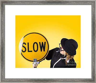 Man Holding Slow Sign During Adverse Conditions Framed Print by Jorgo Photography - Wall Art Gallery