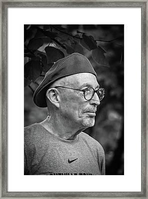 Man In A Nike Shirt Framed Print by John Haldane