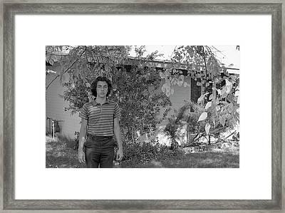 Man In Front Of Cinder-block Home, 1973 Framed Print