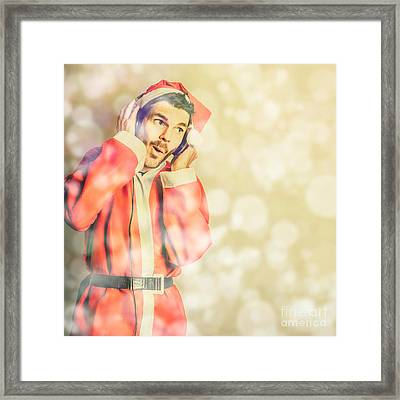 Man In Santa Costume Listening To Christmas Songs Framed Print by Jorgo Photography - Wall Art Gallery