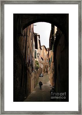 Man In Street-siena Framed Print by Jim Wright