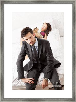 Man In Suit Sitting In Bed With His Wife And A Cat Framed Print