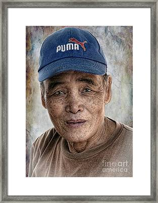 Man In The Cap Framed Print
