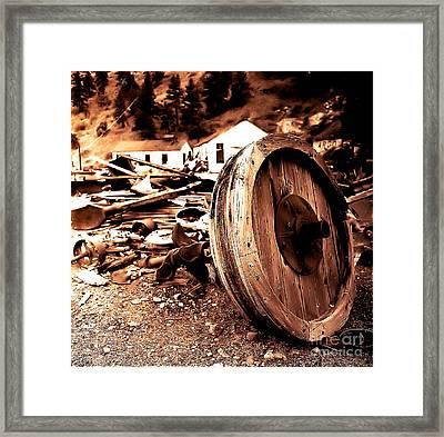 Man Inventid The Wheel Framed Print