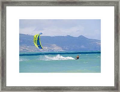 Man Kiteboarding In Turquoise Water Framed Print by Mark Cosslett
