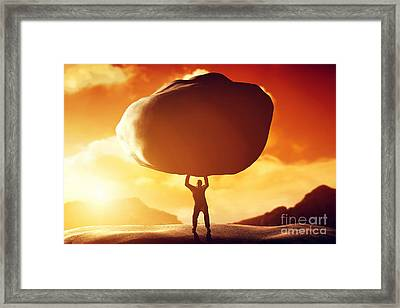 Man Lifting A Huge Rock Framed Print by Michal Bednarek