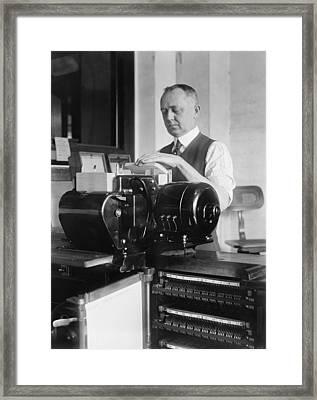 Man Loading Punch Cards Framed Print by Everett