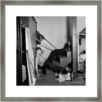 Man Lying At Bottom Of Stairs Framed Print